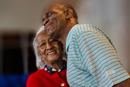 The Rev. Kirbyjon Caldwell thanks volunteer Mary Jackson at the food and clothing distribution center at Windsor Village United Methodist Church in Houston. Photo by Kathleen Barry, United Methodist Communications.