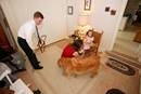 The Pridmore family prepares for church at their parsonage in Rolling Fork, Miss., where the Revs. Eric and Lisa Pridmore pastor a three-point charge. Lisa helps their daughter Mary Ruth with her shoes while Eric and Gene, his Seeing Eye dog, get ready to go. Photo by Mike DuBose, UMNS