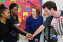 The Rev. Erica Allen in ministry with Project Transformation at Kirpatrick Elementary in Nashville, Tenn. (From left) Chelsi Carr, Briona Jones, the Rev. Erica Allen and Ethan Conner. Photo by Kathleen Barry, United Methodist News.