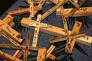 "A table filled with small crosses presents participants at Brentwood United Methodist Church to literally ""carry the cross"" as they meditate on the twelve stations of the cross. Photo by Kathleen Barry, UMNS 3/31/10."