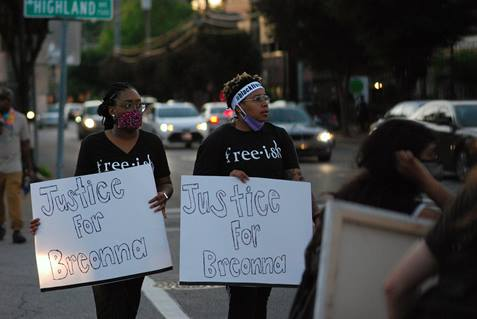 Two women march with signs calling for justice for Breonna Taylor during protests in Louisville, Kentucky, over the police killings of Taylor in Louisville, George Floyd in Minneapolis, Minn., and other African Americans. Photo by Cathy Bruce, courtesy of the Kentucky Conference.